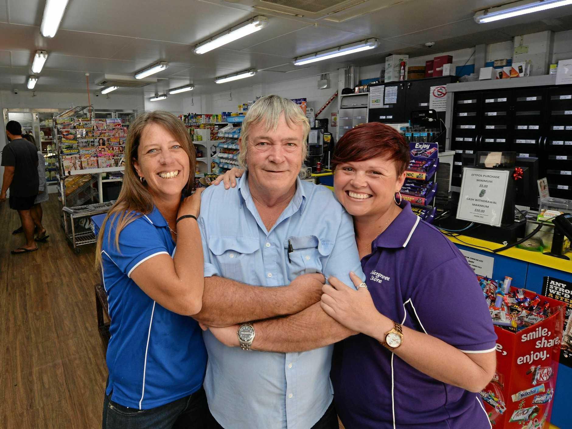Sonya McLeod, Jeff Richardson and Renae Murphy celebrate Andergrove Store's 25th birthday.