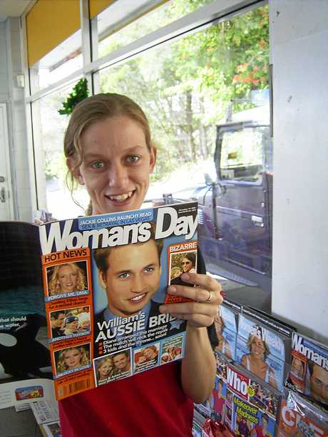 Jenny Mason of the Noosa Heads Shell Service station with the magazine featuring Prince William, which Prince Harry read through during a brief visit.