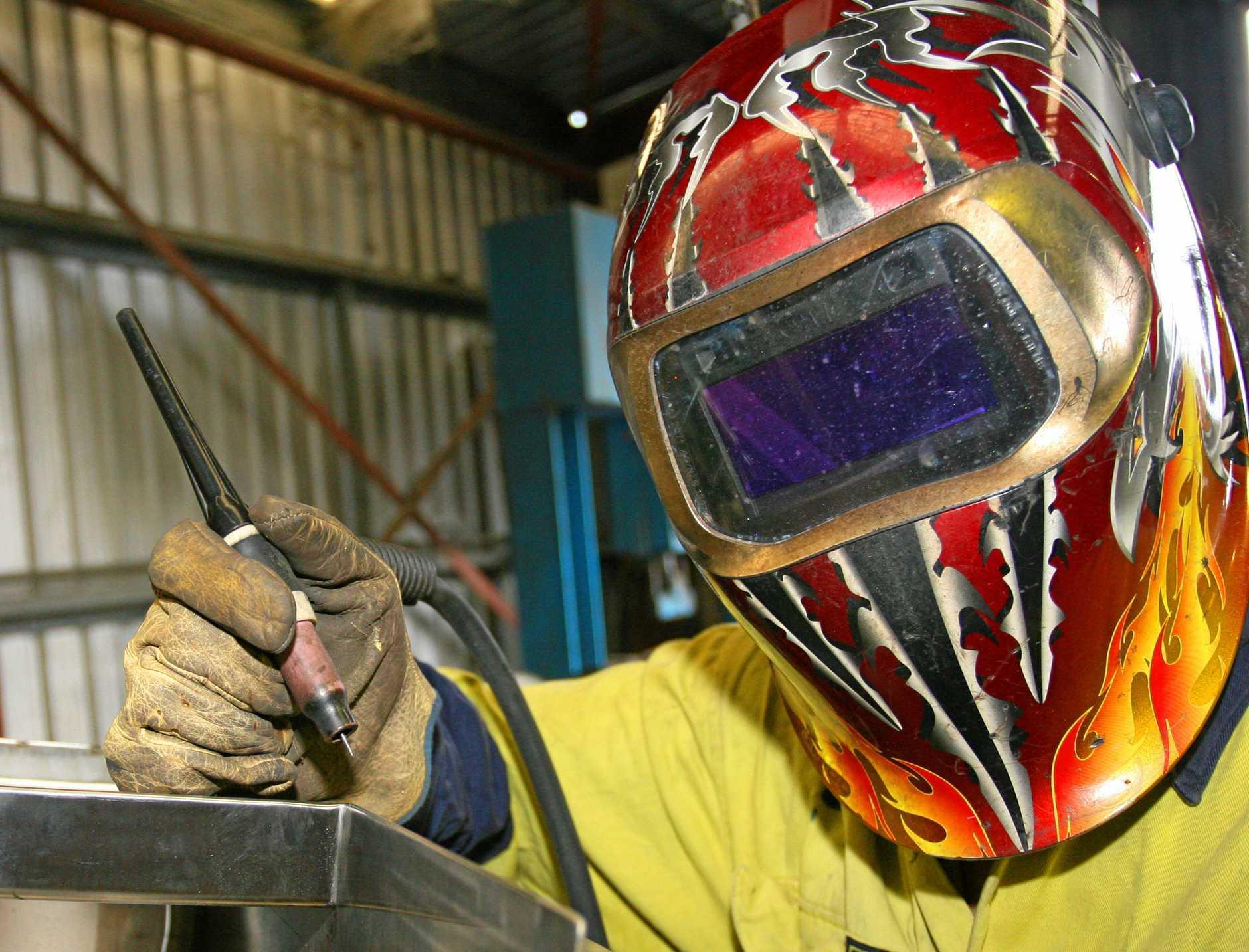 Sheet metal apprentice Quang Nguyen at Adnought Sheet metal Fabrications.   Photo: Chris Ison / The Morning Bulletin