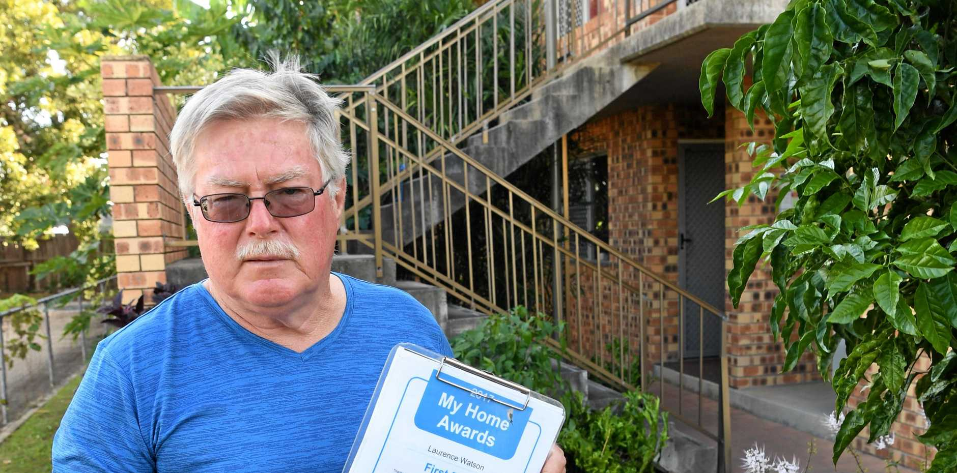 TOO MUCH MULCH: Laurie Watson has been clashing with the Department of Housing over his garden.