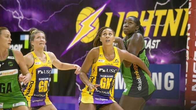 CAPTAIN: Sunshine Coast goal keeper Geva Mentor, centre, in action against West Coast Fever at USC Stadium on Saturday.