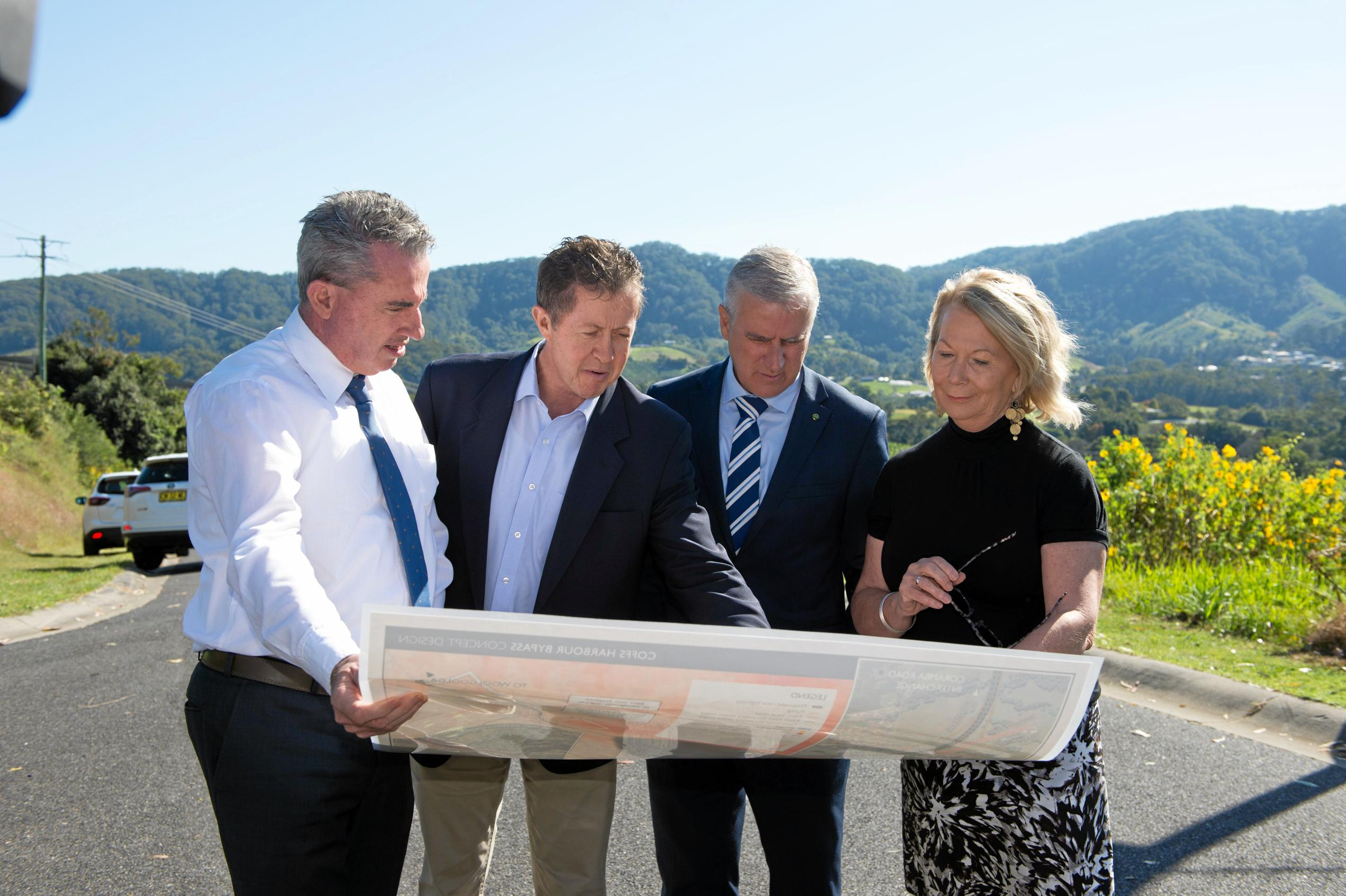 INSPECTING THE ROUTE: Member for Page Kevin Hogan, Cowper MP Luke Hartsuyker, Deputy Prime Minister Michael McCormack and Coffs Harbour Mayor Cr Denise Knight look over the map of the proposed route of the Coffs Harbour bypass.