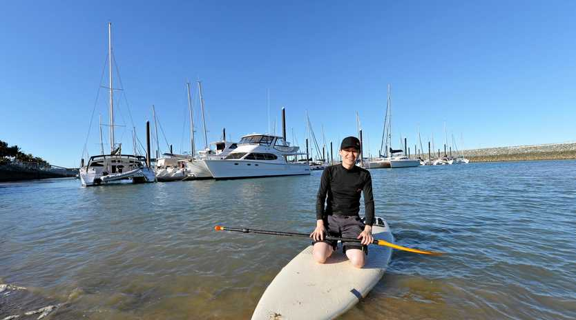 WATER WEEK: Ricky Zhan of North Mackay practices his stand up paddleboarding skills at Mackay Marina in Try the 5's water sports week.