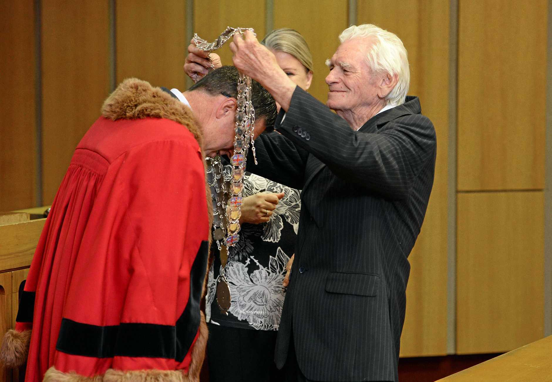 John Nugent hands the mayoral chains to Andrew Antoniolli.