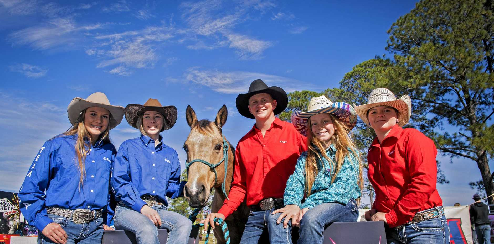 FROM LEFT: McKenna Battjes, Kaily Sooy, Ryley Burke (with Rebel), Sky Sanders and Emi Carlson prepare for tomorrow's under-18 International Barrel Race competition. ABSENT: Georgie Sarginson.