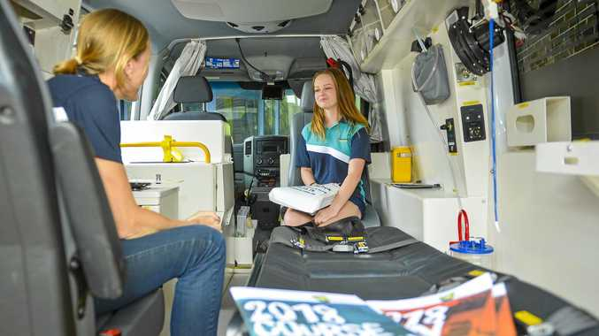 LIFE LESSONS: Lisa Hurring talks to Year 12 Tannum State High student Courtney Sullivan in the Paramedic Science Training Centre at the 2018 Gladstone Careers Expo.
