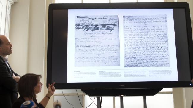 A video shows the text underneath two taped off pages from Anne Frank's diary during a press conference at The Anne Frank Foundation's office in Amsterdam. Picture: AP Photo/Peter Dejong