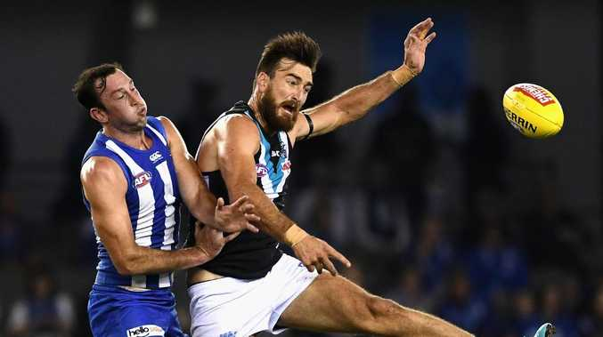 Charlie Dixon competes against North Melbourne's Todd Goldstein. Picture: Quinn Rooney/Getty Images