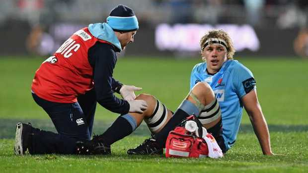 Ned Hanigan of the Waratahs receives medical help at AMI Stadium.