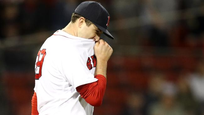 BOSTON, MA - MAY 14: Carson Smith #39 of the Boston Red Sox reacts after Khris Davis #2 of the Oakland Athletics hit a home run during the eighth inning at Fenway Park on May 14, 2018 in Boston, Massachusetts. (Photo by Maddie Meyer/Getty Images)