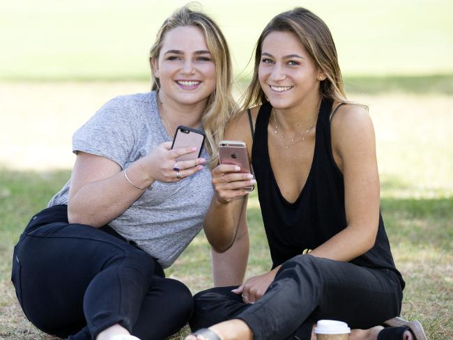Texting and social media are the main means of communication for millennials and Gen Zers like sisters, Sophie, 22, and Lucy Welsh, 21. Picture: Sarah Matray
