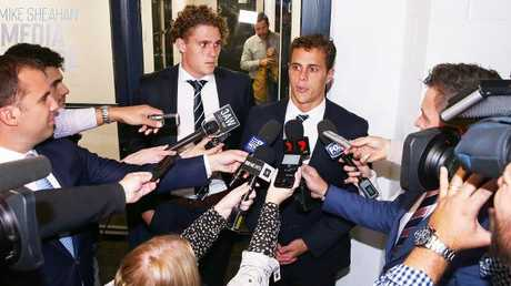 Charlie and Ed Curnow speak to the media.