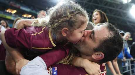 Cameron Smith celebrates with his daughter after a State of Origin victory in Sydney. Picture: Brett Costello