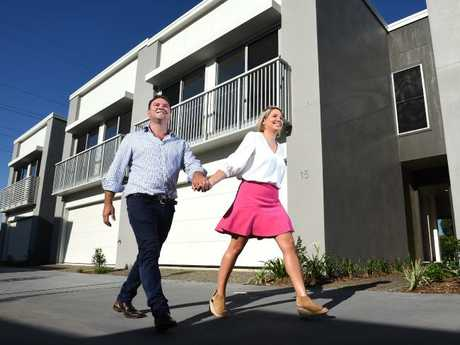 Millennials Matt Brandon and Alice Tidmarsh bought their first property together earlier this year in Cannon Hill, QLD. Millennials are driving optimism to buy property in 2018. Picture: John Gass/AAP