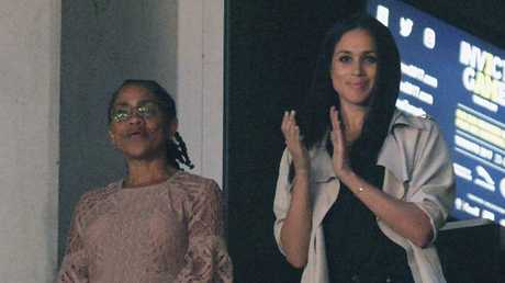 Meghan Markle, right, watches the closing ceremonies of the Invictus Games with her mother Doria Ragland in Toronto last year. Picture: Nathan Denette/The Canadian Press via AP