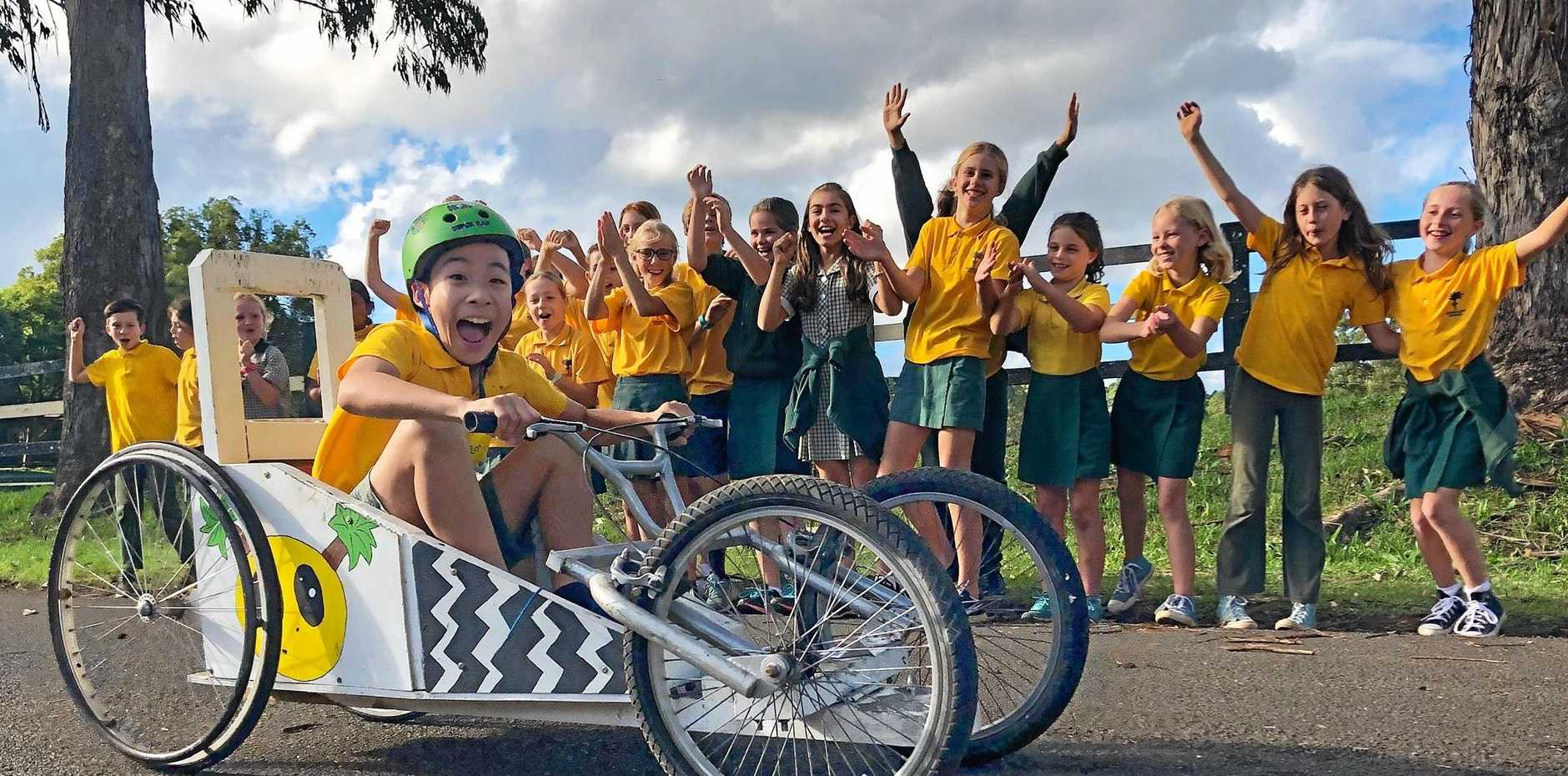 READY, SET, ROLL: Roi at the controls as Bangalow Public School billycarters get ready for the Bangalow Billycart Derby.