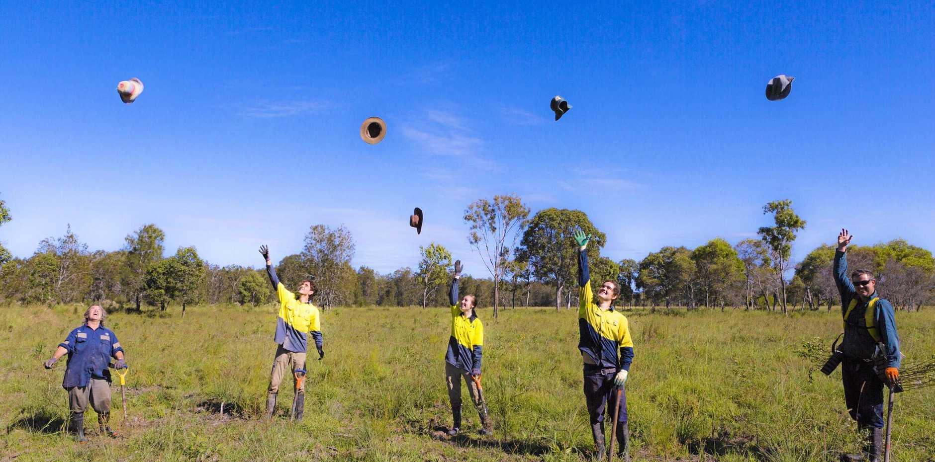 JOB DONE: Workers celebrate planting 340,000 trees at Elanda Plains.