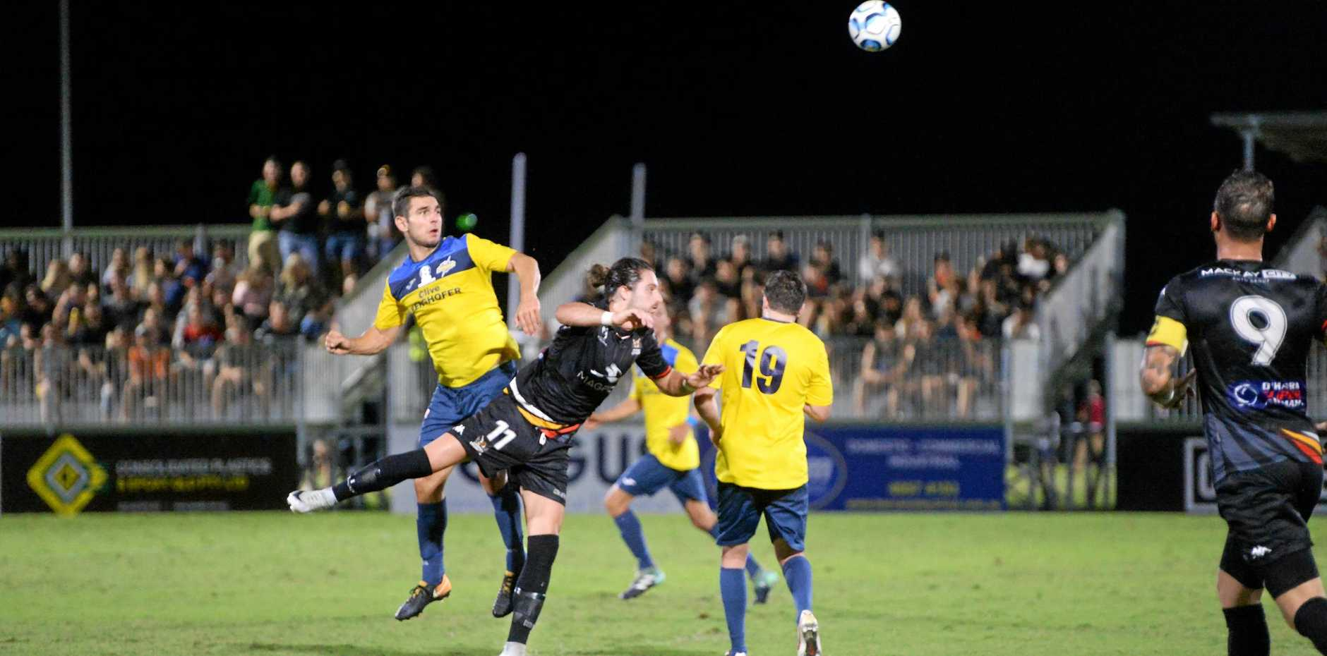 Magpies Crusaders striker Kyle Markham flies for a header against SWQ Thunder in round seven of the NPL Queensland at Sologinkin Oval.