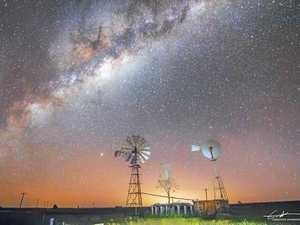 'Windmills under a starry night'