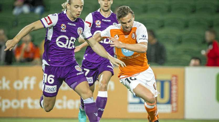 Brisbane Roar's Brett Holman keeps Perth Glory's Joe Mills at bay in their sides' round 27 A-League match on April 14.