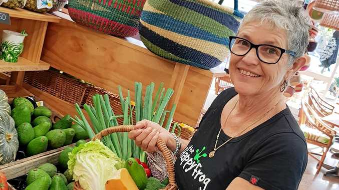 LEAPING IN: The Happy Frog owner Kim Towner puts together a basket of the store's beautifully fresh vegetables, as she asks for opinions on a possible delivery service.