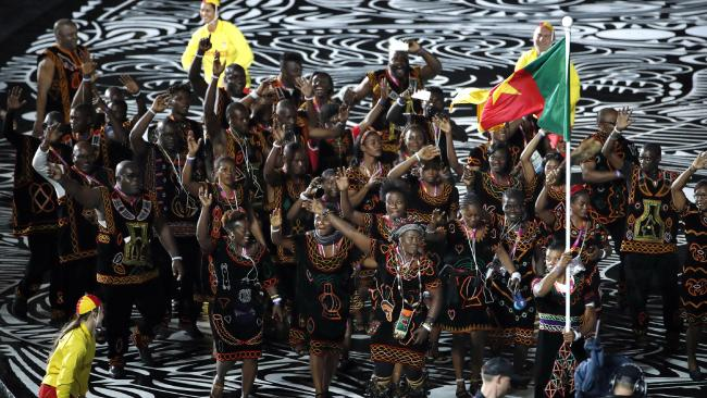 The Cameroon team marches for the Commonwealth Games opening ceremony. Picture: Mark Schiefelbein