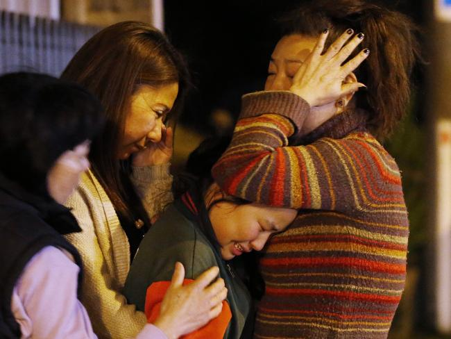 Family members, including Aivy's younger sister, 10, visit the scene on Wednesday night. Picture: David Caird