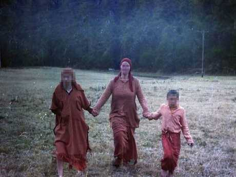 Shishy' (centre) pictured with other residents at the Satyananda Yoga Ashram at Mangrove Mountain.