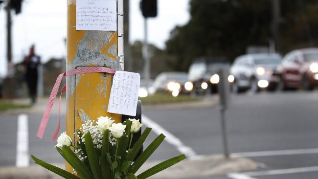 Tributes left at the scene. Picture: David Caird