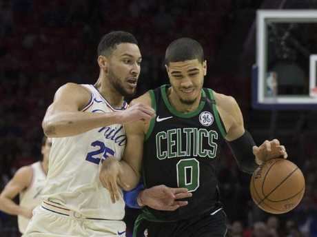 Ben Simmons (left) and Jayson Tatum battle during the playoffs.