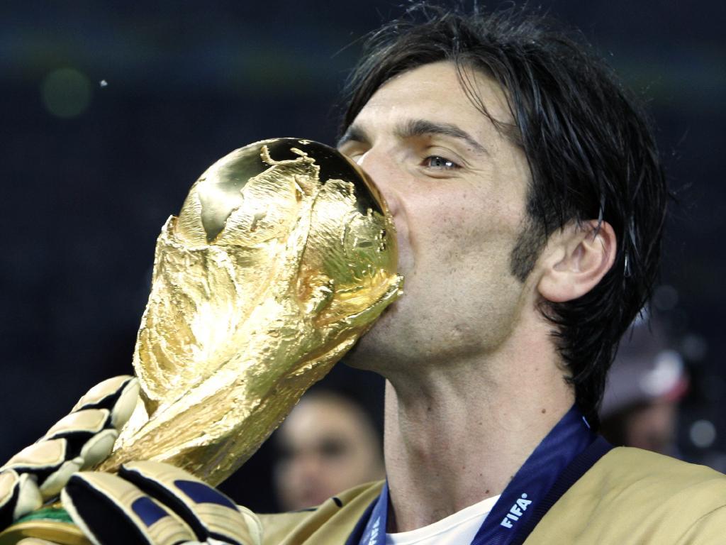 Gianluigi Buffon kisses the World Cup trophy in 2006.