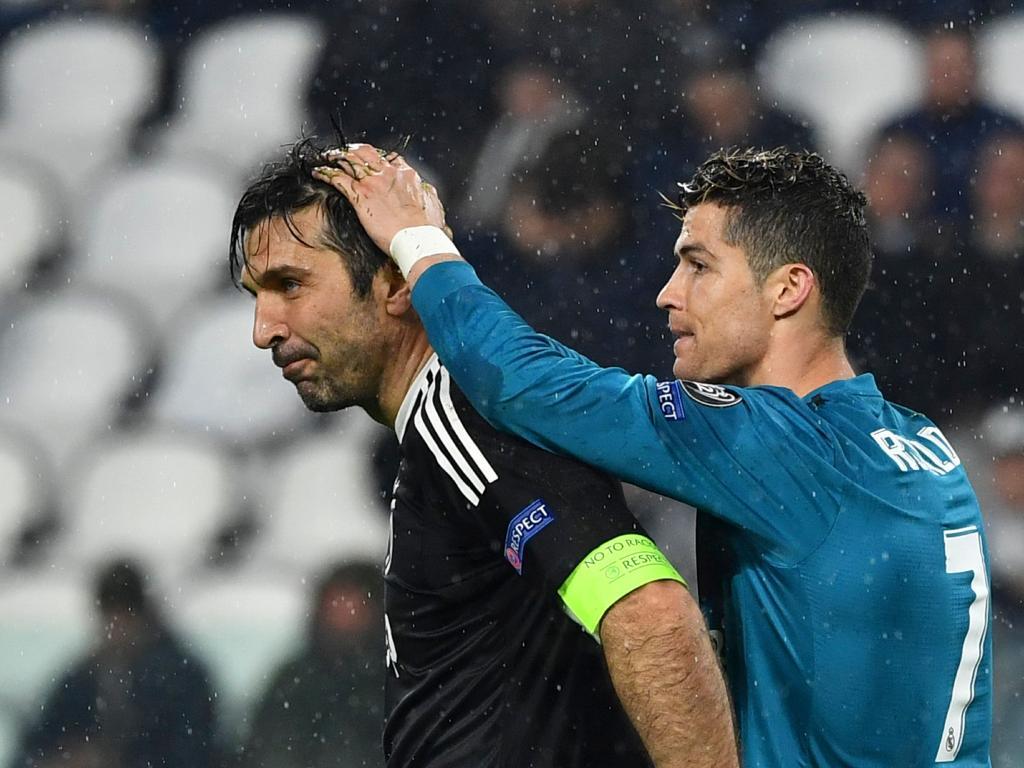 Cristiano Ronaldo jokes with Gianluigi Buffon.