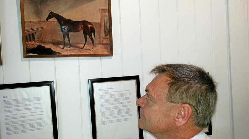 TREASURE TROVE: Ipswich Turf Club general manager Brett Kitching admires one of his favourite pieces in the newly opened Ipswich Racing Museum.
