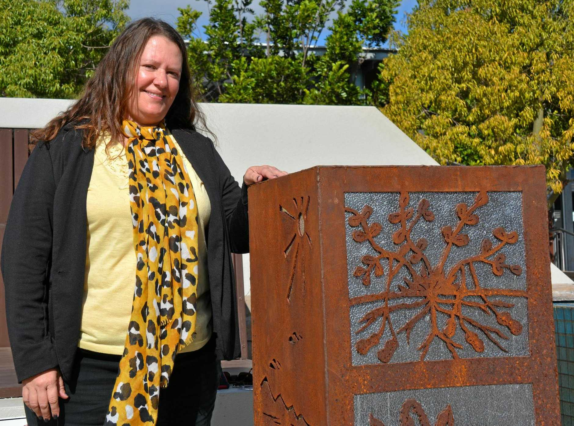 SUPPORT FOR THE ARTS: South Burnett Regional Councillor Danita Potter with Ina Patterson's sculpture, Postcards from the South Burnett.