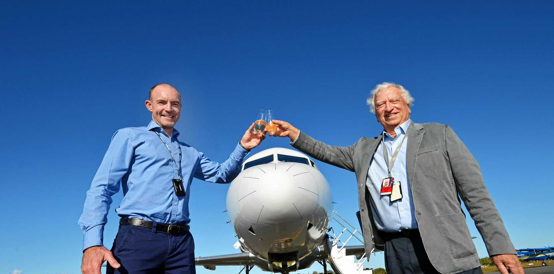 The Fokker 70 Corporate Airliner touches down at the Sunshine Coast Airport. The airliner was previously owned by the Dutch royal family and will now operate under contract with Alliance Airlines. Alliance chief executive officer Lee Schofield (left) and Flights Options managing director Steve Padgett.