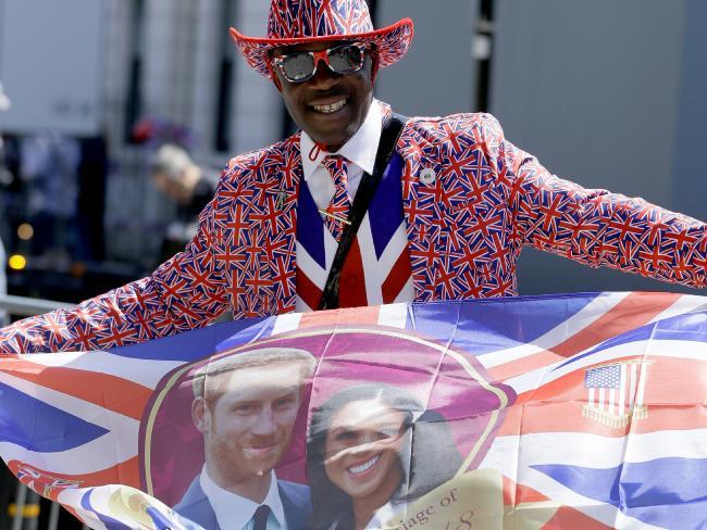 A royal fan waves a flag in Windsor.