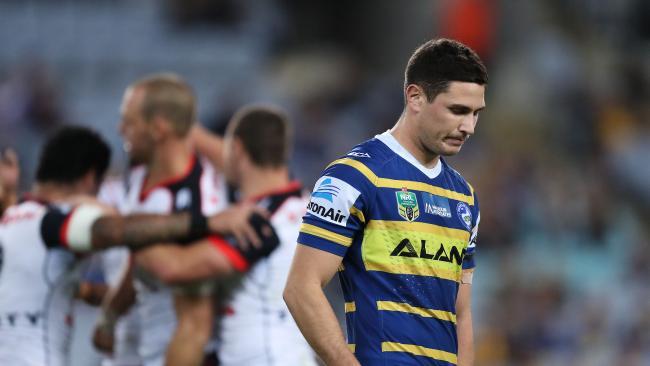 Parramatta's Mitch Moses suffers as the Warriors celebrate. Picture: Brett Costello