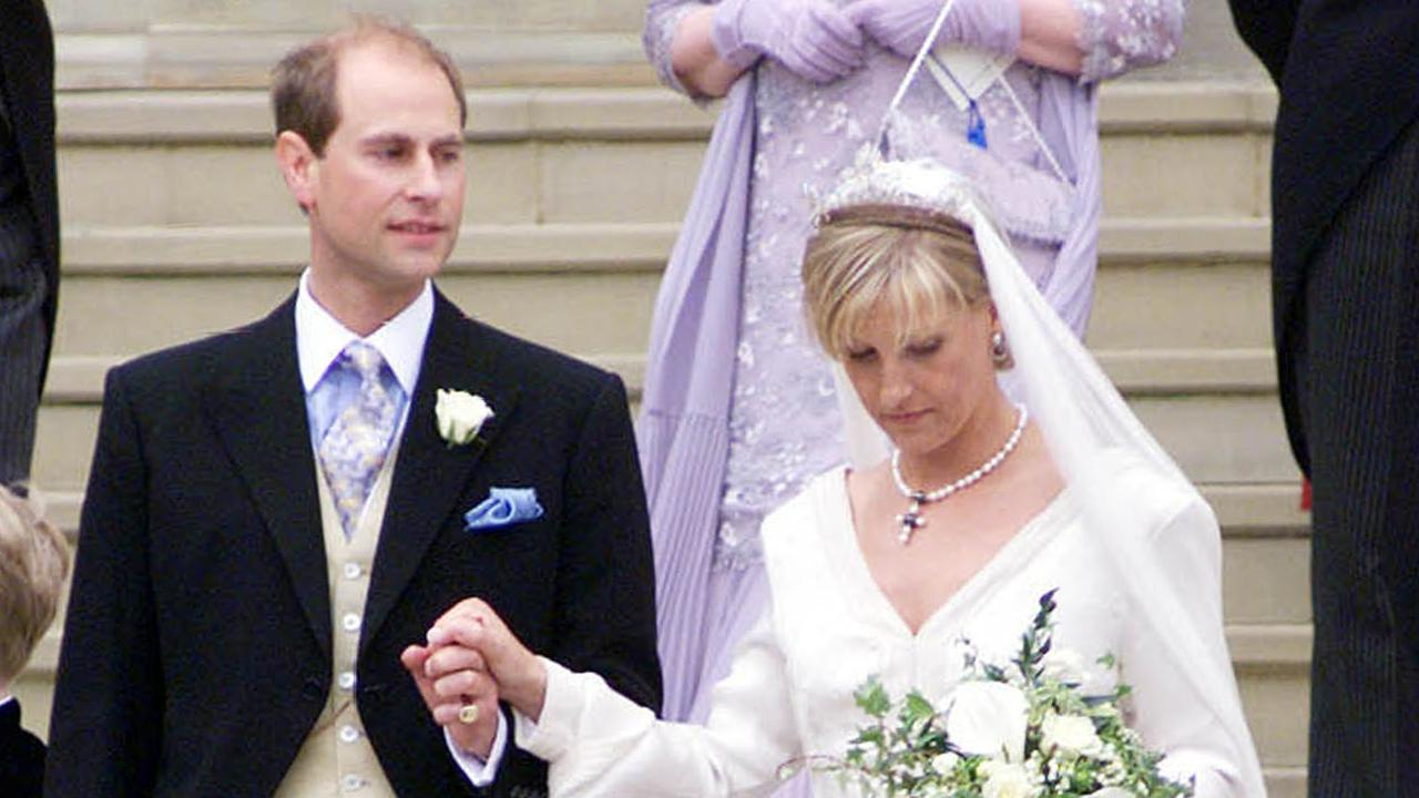 Prince Edward and his bride Sophie Rhys-Jones, leave St George's Chapel in 1999. Picture: AP