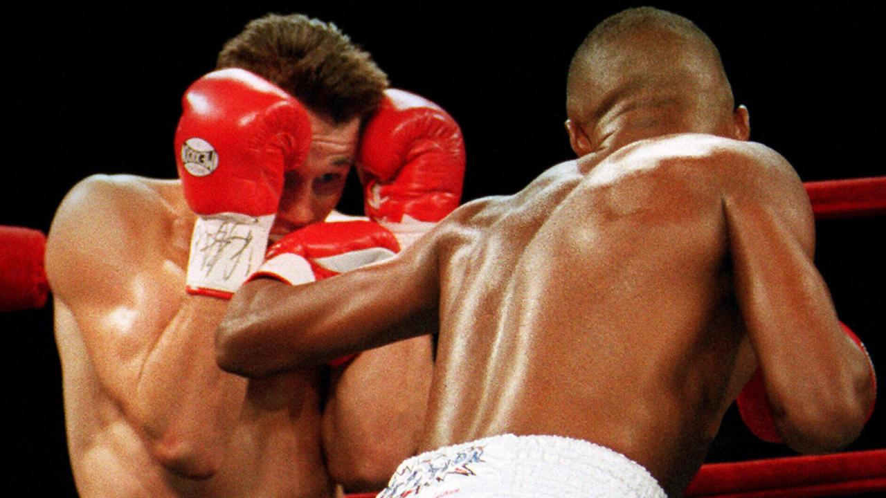 Troy Waters covers up against Felix Trinidad.