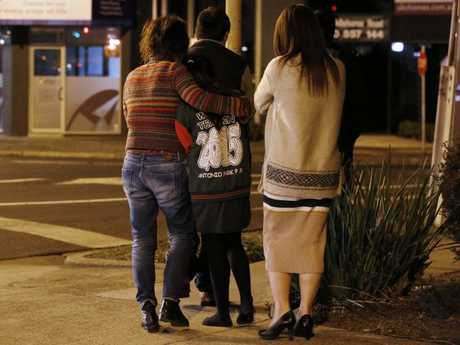 Aivy Nguyen's grieving family gathered at the scene on Wednesday night. Picture: David Caird