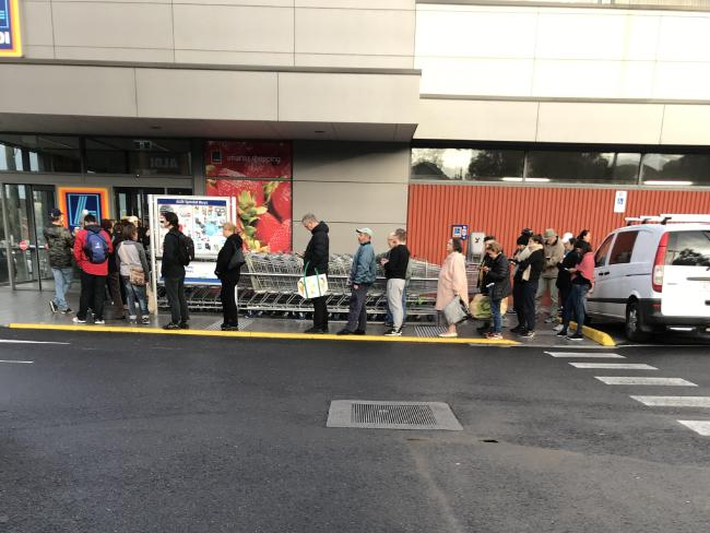 The line snaked around the store at Preston South on Saturday morning.