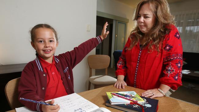 Isla, 7, tells mum Yetta Nelson she doesn't need help with her homework.