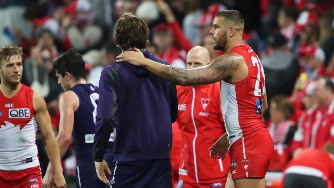 Sydney's Lance Franklin checks on Joel Hamling after the game. Picture. Phil Hillyard