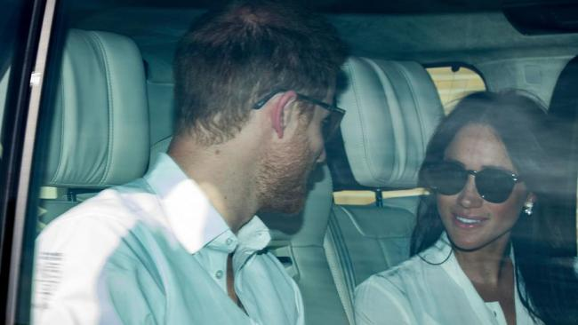 Prince Harry and Meghan Markle are seen arriving for a wedding dress rehearsal, both wearing dark sunglasses. Picture: Paul Edwards/The Sun