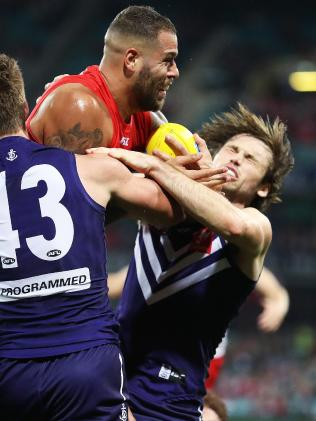 Sydney's Lance Franklin collects Fremantle's Joel Hamling. Picture. Phil Hillyard