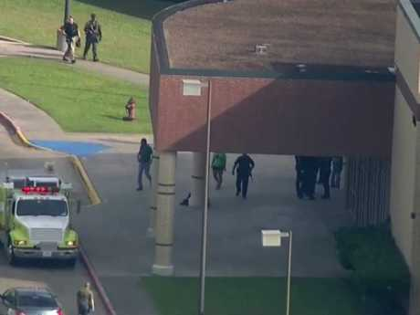 Law enforcement officers arrive at the school after reports of a gunman opening fire on students. Picture: KTRK-TV ABC13 via AP