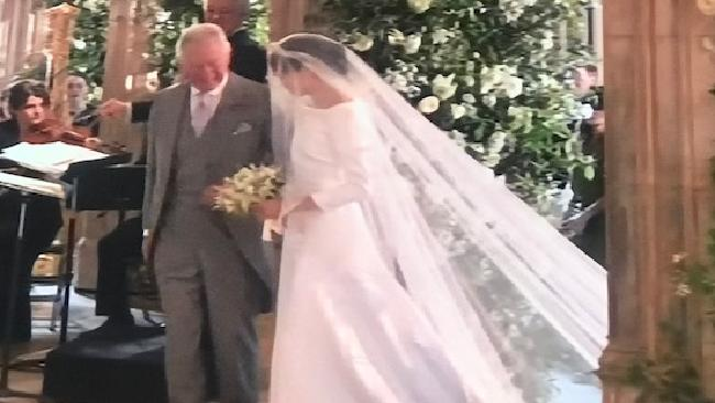 Prince Charles walked her down the aisle.