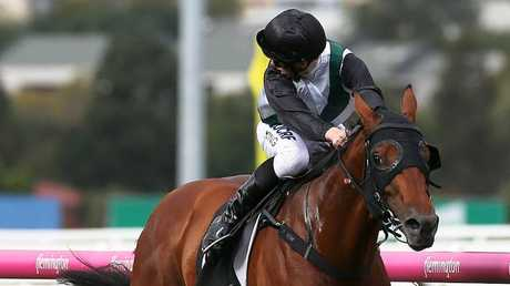 Lachlan King looks for the opposition as Boom Time scored a runaway win at Flemington. Picture: AAP