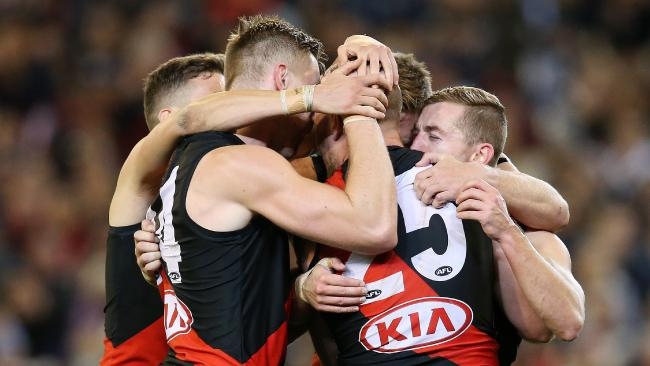 Essendon players celebrate their win. Pic: Michael Klein