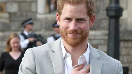 Prince Harry smiles as he comes out to meet wellwishers on the street outside Windsor Castle. Picture: AFP/Jonathan Brady